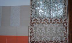 roman curtains on our bathroom window