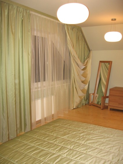 green non standard window curtains in bedroom