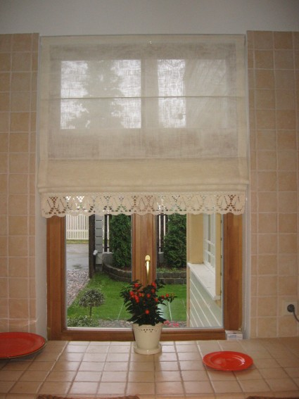 roman curtains with flower on the windowsill